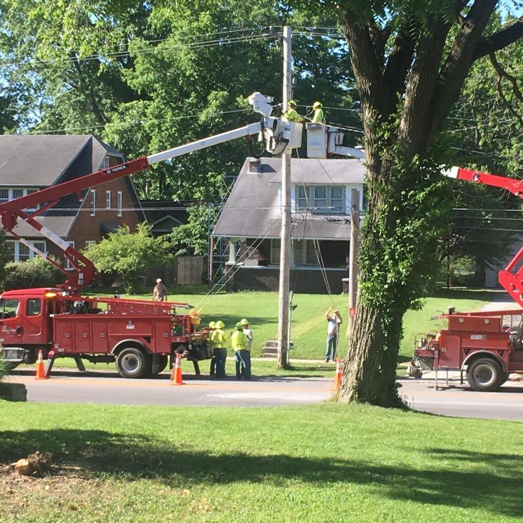 Utility crew working on pole